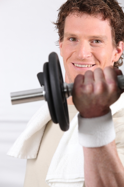 2845798-s-young-man-doing-exercises-with-a-dumbbell